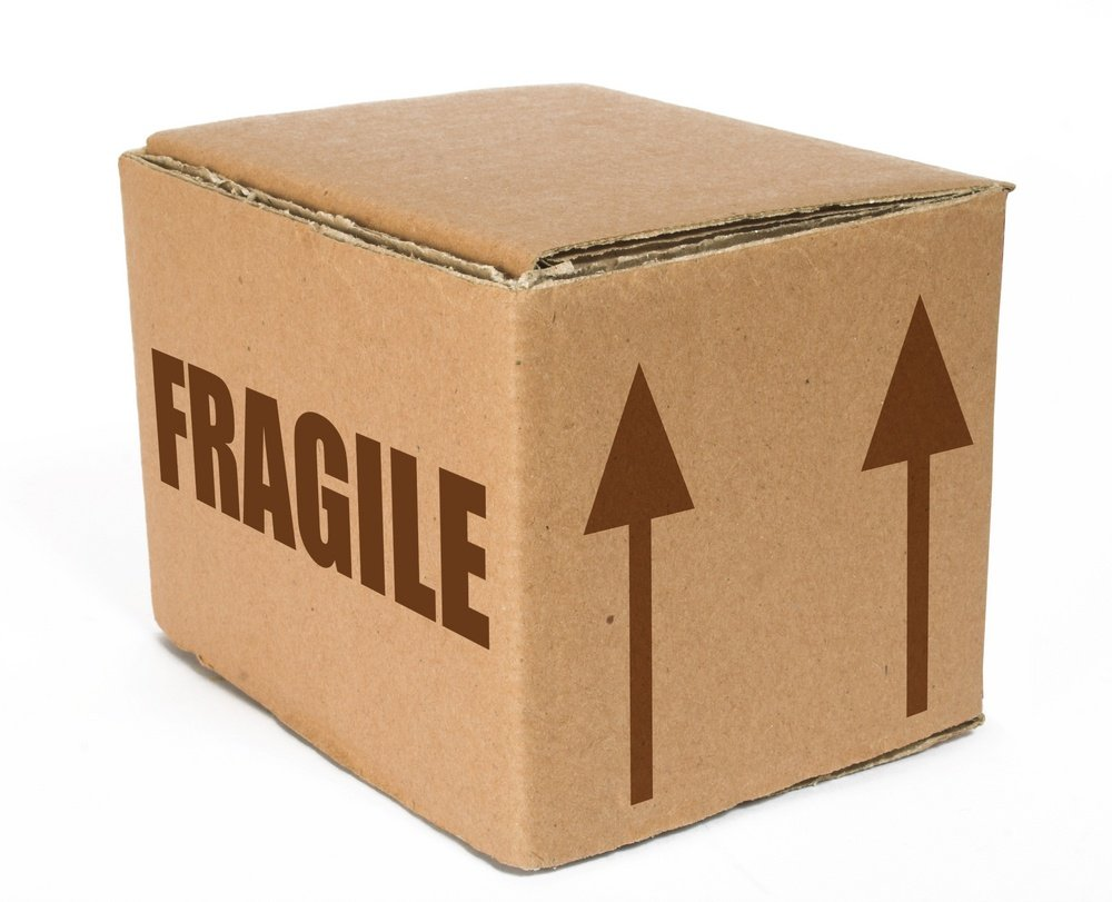 cardboard box with the word fragile on it and arrows pointing up